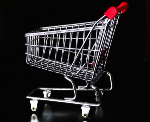 Silver grocery cart with red handle