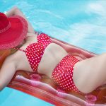 Woman on raft in red bikini in pool