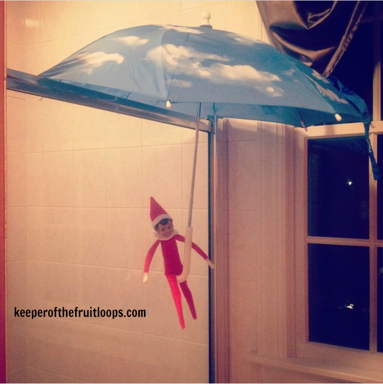 Elf on The Shelf with umbrella in shower.